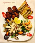 Italian feast antipasto illustrated by a plate of seafood.